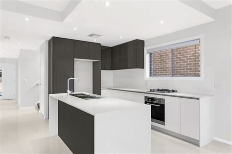 waterfall stone bench tops kitchen in a custom designed home with waterfall ends