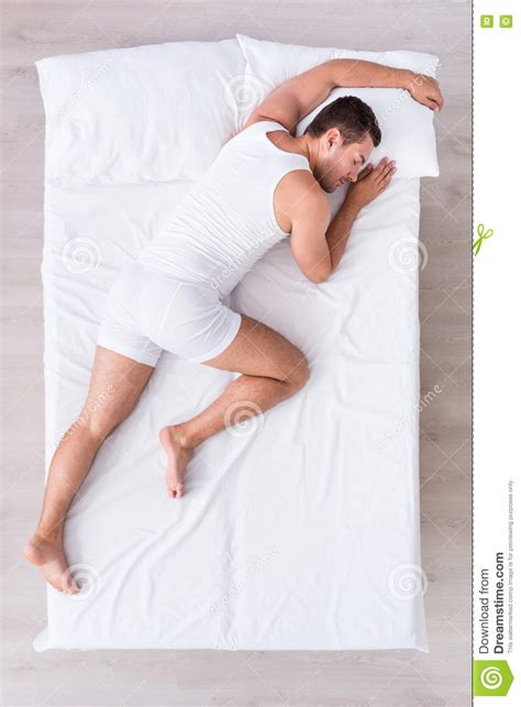 lying on my bed relaxed young man lying on bed stock photo image 76446946