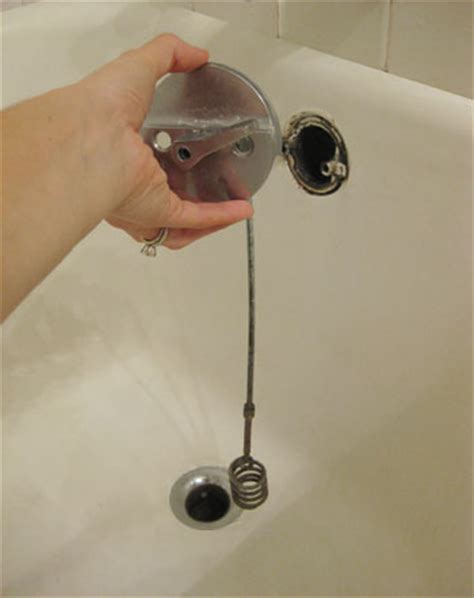 hair clogged bathtub how to unclog a super backed up drain young house love