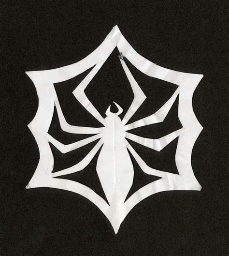 How To Make A Spiderweb Out Of Paper - skellington paper cut out spider web snowflake from