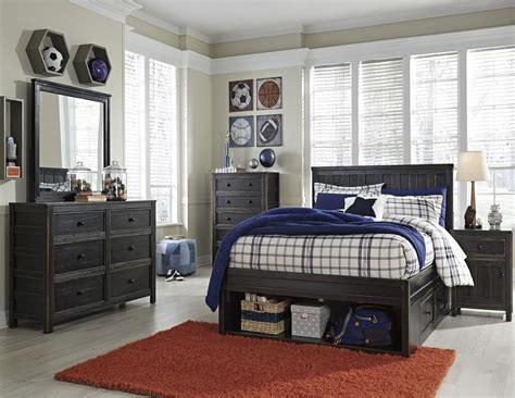 storehouse bedroom furniture jaysom black youth panel storage bedroom set from ashley