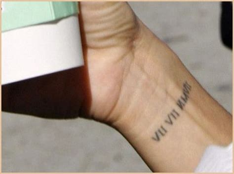 small numerals date on arm tattoomagz