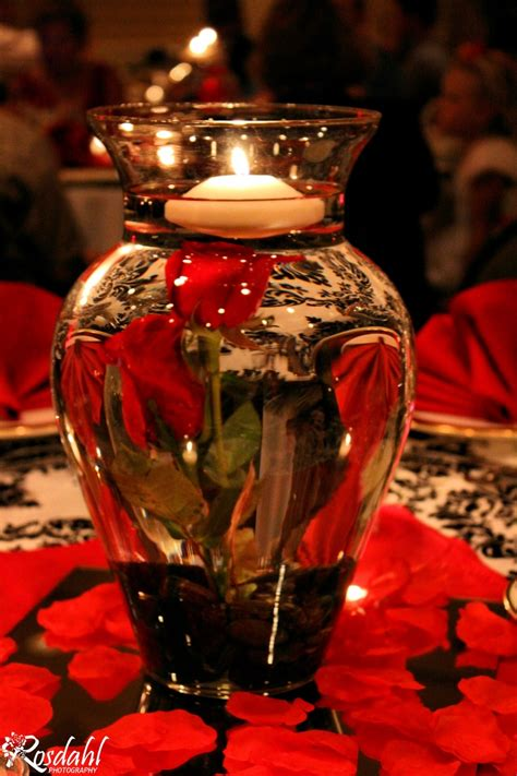 water vase centerpieces easy to make wedding centerpieces two roses water a vase and river stones from the dollar