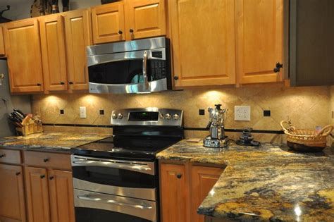 purple kitchen backsplash purple dunas granite countertop with durango tile backsplash traditional kitchen