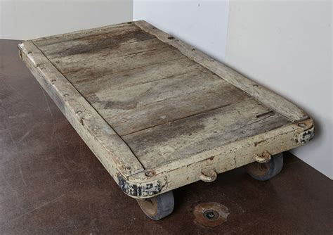 antique oak rail station cart as coffee table at
