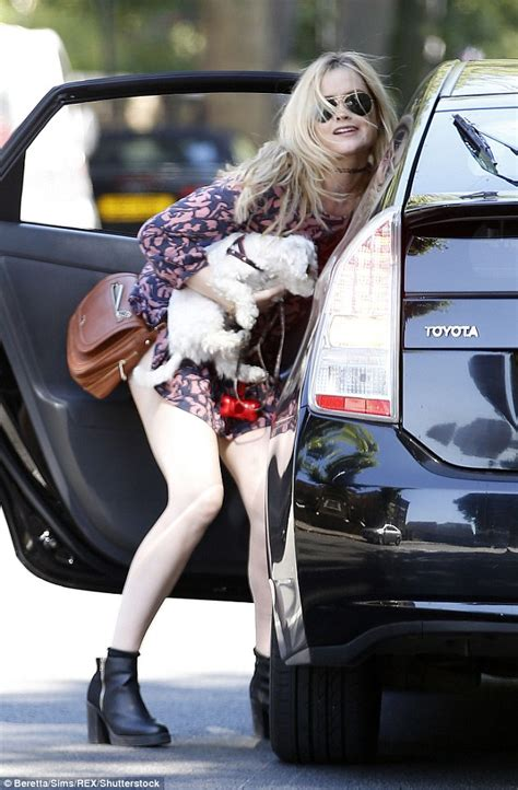 Wardrobe Getting Out Of Car by Whitmore Puts On Leggy Display With Pet