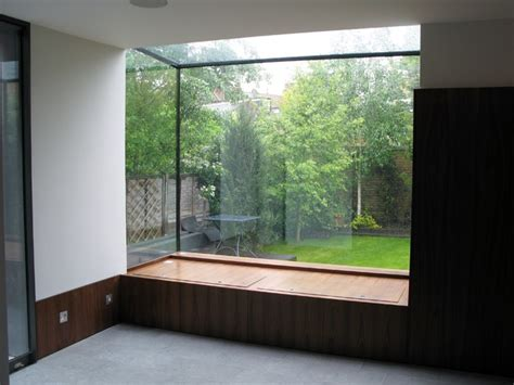 glass window box window seat with storage constructed within glass box