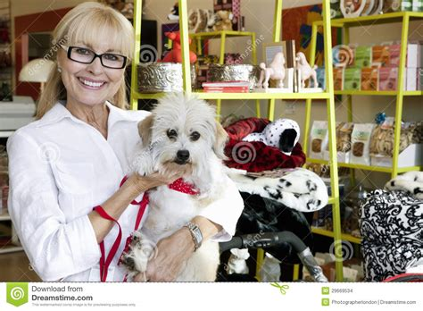 pet shop puppies portrait of a happy senior carrying in pet shop stock images image 29669534