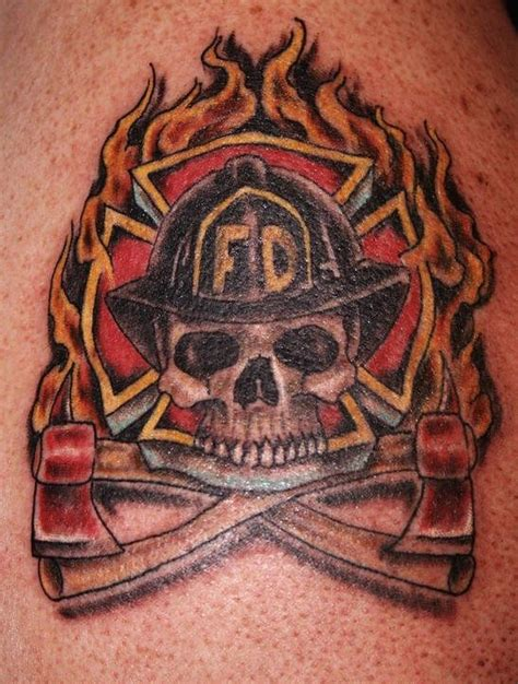 skull firefighter with flaming helmet tattoo on half firefighter images designs