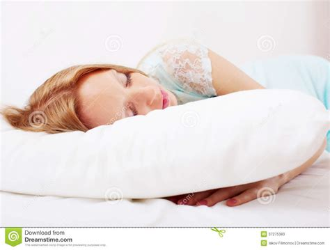 Sleeping On Pillow by In Nightshirt Sleeping On White Pillow Stock Photos