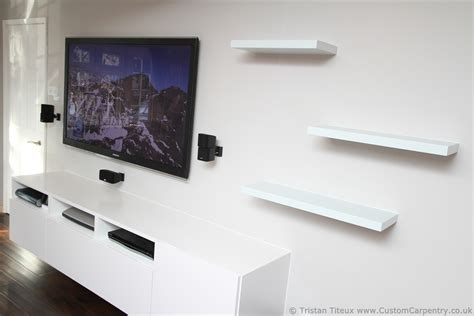 floating shelves around tv fitted floating shelves empatika