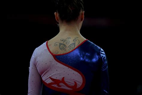 gymnastics tattoos olympic ink 50 more tattoos on the world s best athletes