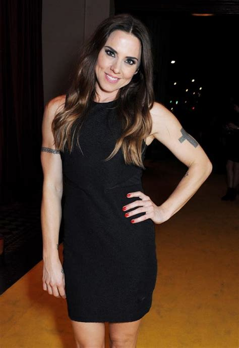 mel c shows off new feather tattoo