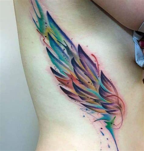 tatuajes de alas diferentes estilos a color en negro y