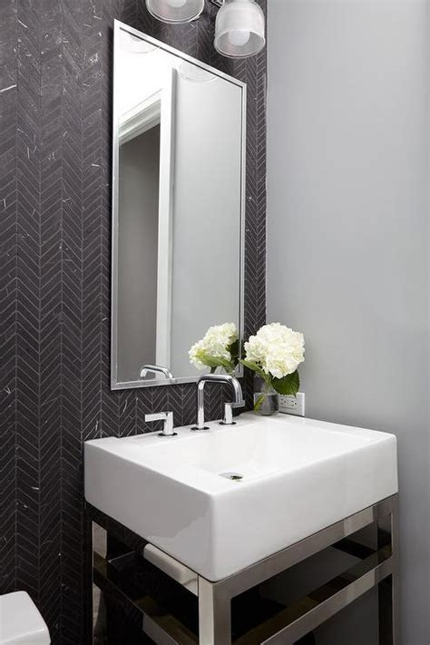 Powder Room with Black and White Herringbone Floor Tiles