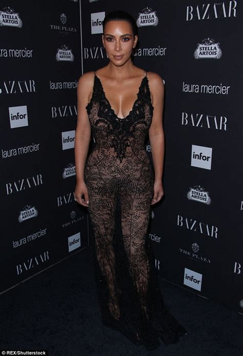kim kardashian net jumpsuit daily mail kim kardashian wears a see through black lace dress at