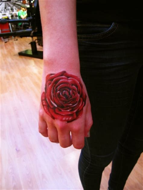 hand tattoo red red rose hand tattoo flower tattoos pinterest
