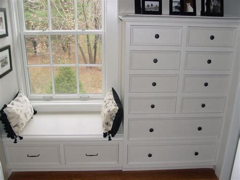 built in dresser with window seat living room