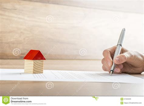 buying a house signing contract signing contract of house sale royalty free stock photo cartoondealer com 35601807