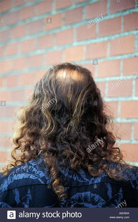 men long hair cover bald spot back view of man s head with bald spot and long shoulder