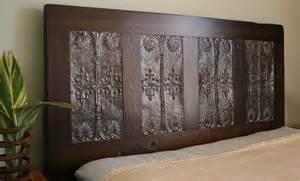 headboard made from reclaimed door and by doormandesigns