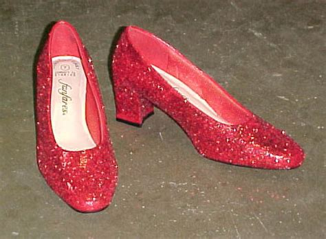 ruby slippers under house wizard of oz event decor