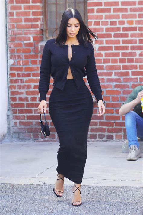 latest on kim kardashian news kim kardashian in pencil skirt and open cardigan kim