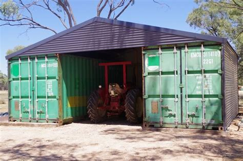tractor parked  shipping container shed chalet