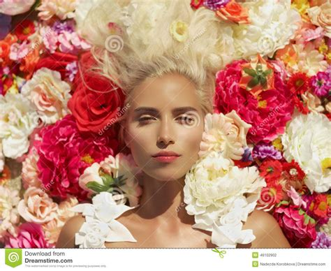 girl lying bed with flowers beautiful lady lying in flowers stock photo image 46102902