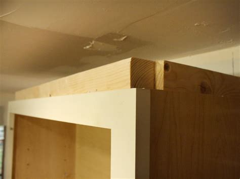 kitchen cabinet crown molding installation how to install cabinet crown molding how tos diy