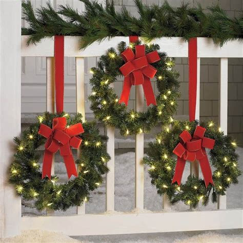 find your joy 24 lighted holiday bow 10 front door wreaths you can buy right now or diy