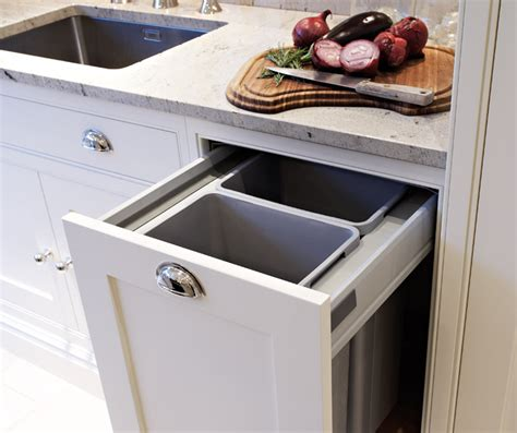 kitchen cabinet recycle bins hidden garbage can in transitional kitchen cabinetry