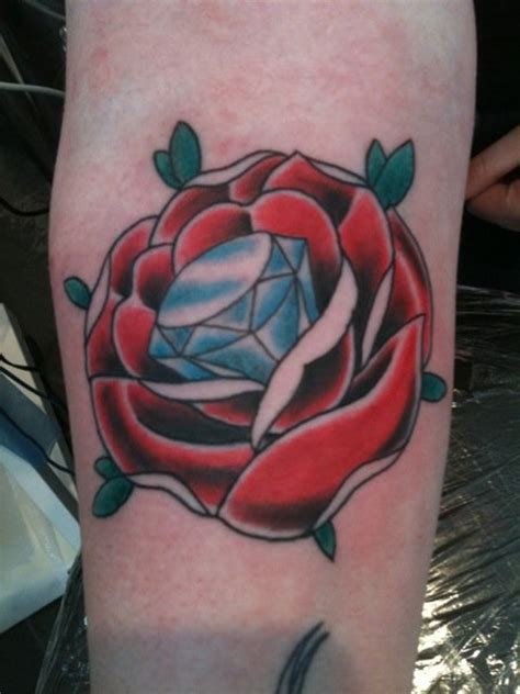 rose tattoo on elbow blue on