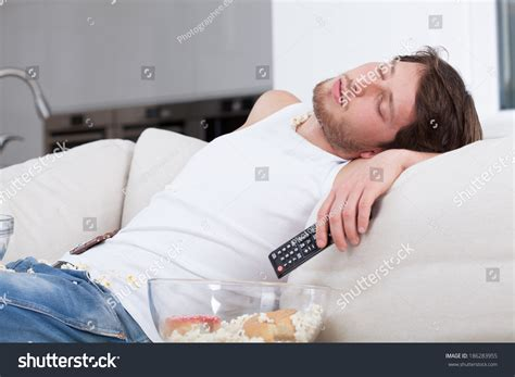 sleeping on the couch depression tired man sleeping on couch front stock photo 186283955