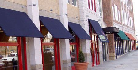 Awning And Sign Contractors by Many Companies Are Now Using A Mix Of Canvas And Metal Awnings On Their Storefronts Awnings