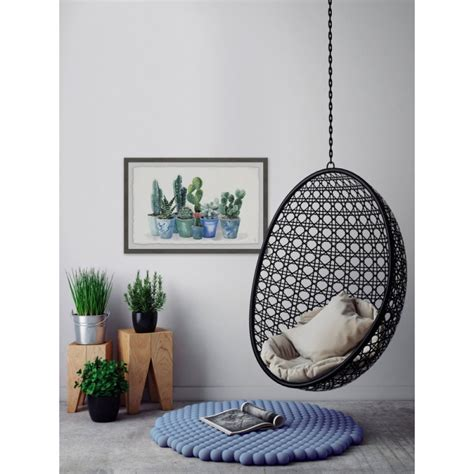 trend  hanging wicker egg chairs  indoors
