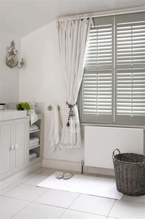 how to dress windows soften the look of shutters with curtains