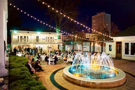 beautiful reception outdoor string lights water event planning mississippi
