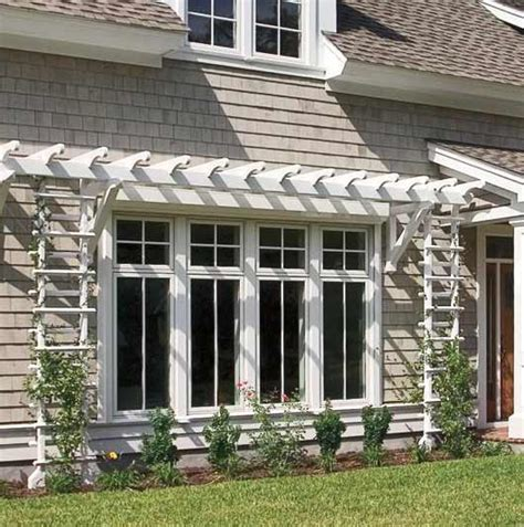 decorative fence definition a shallow pergola and trellises give definition to this
