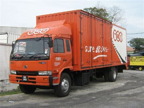 Truck Photos Orange Nissan Diesel Truck Of Tnt In Malaysia