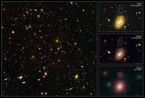 spitzer  hubble team   find big baby galaxy   newborn universe esahubble