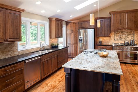 cherry wood kitchen cabinets with black granite black galaxy granite countertop kitchen traditional with
