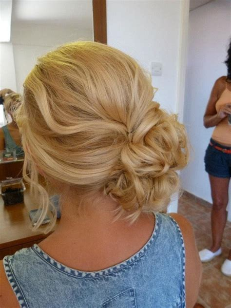 how to comb a bun with side swept bangs prom hair side low updo seniors pinterest updo