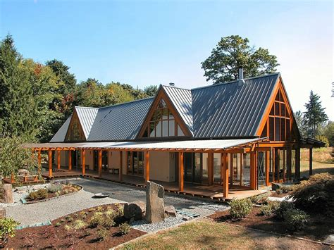 house plans with high pitched roofs cabin chic mountain home of glass and wood