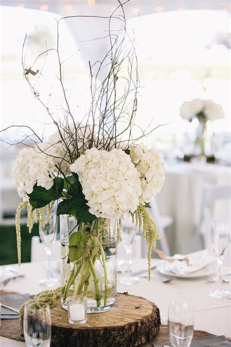 tree centerpieces wedding rstic white hydrangea and tree stump wedding centerpiece