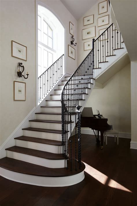 black staircase banister rod iron railing staircase traditional with arch window