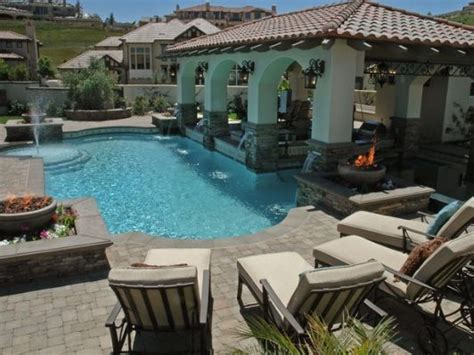 what is backyard in spanish pool and pavillion set in spanish style home and garden
