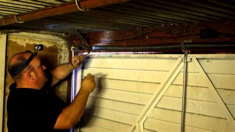 how to adjust the tension on a garage door in