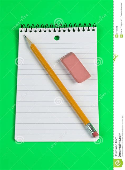 armed with a pad of paper and pencil she began to survey her neighbors pencil and eraser on a pad of paper stock photography
