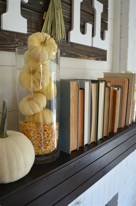 fall mantel books pumpkins vintage nest